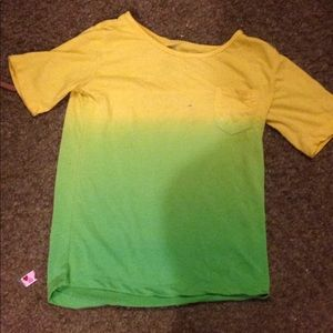 A green and yellow firefly shirt short sleeves